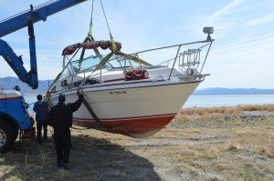 No one knew how long the 28-fooot Sea Ray boat lay by the shores of Walker Lake — too long for Sheriff Stewart Handte's taste. Using his authority under the