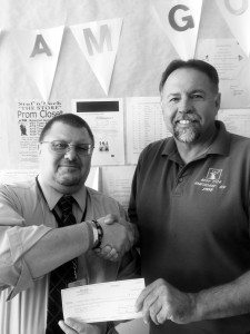 Hawthorne Elks Exalted Ruler Steve McBride presented a check to Mineral County High School Principal Mike Domagala for $200 as a donation for the use of