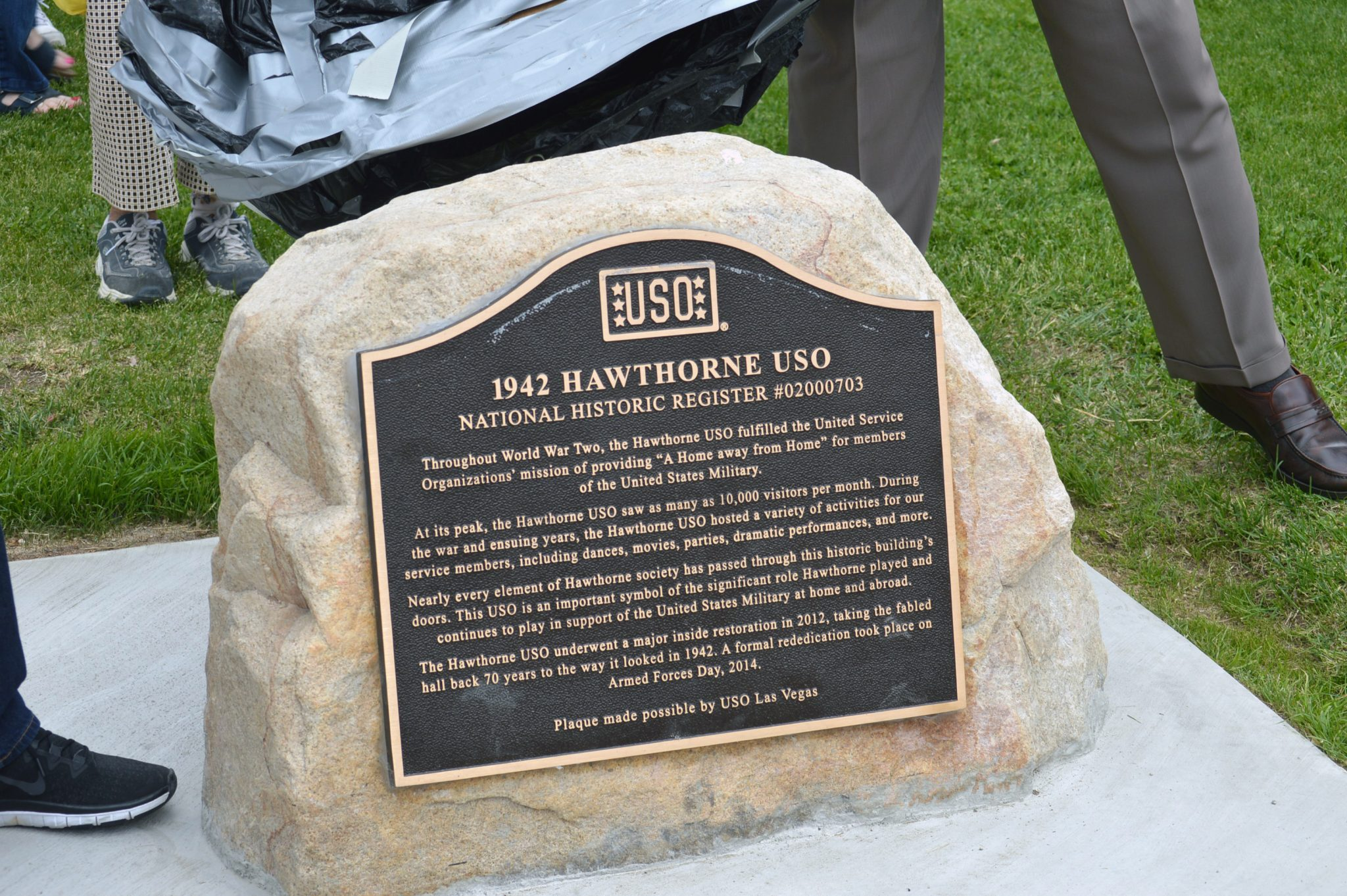 Memorial USO plaque details history of historic building