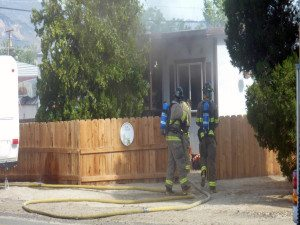 At about 8:55 a.m. on July 21, Mineral County Dispatch notified emergency services personnel of a structure fire located at 305 J St. Tom