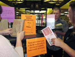 "The library's annual Banned Books event is on display throughout the library. Patrons can fill out a form to ""ban"" a book."