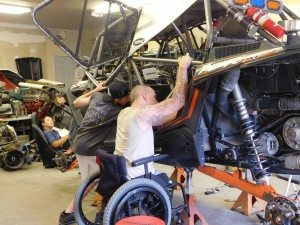 Sheri Samson Tim Hall and his crew work on his vehicle in preparation for Friday's Vegas to Reno off-road race.