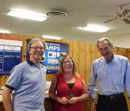 Sheri Samson New Mineral County postmaster Kerrin Duff, center, with post office workers Steve Waldon (left) and Dan Collier.