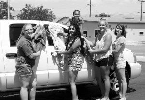 Sheri Samson A few Mineral County High softball players take a moment from their fundraising car wash to smile on Saturday.