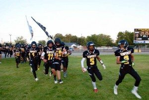 Jason Cardenas Mineral County High football players sprint onto the field before their season-opening matchup with Tonopah Friday night in Hawthorne. The Serpents led early, but couldn't hang on in a 49-30 loss to the Muckers.