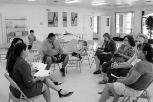 Hillary Clinton campaign workers discuss the presidential candidates stance on issues and ideas in Schurz Aug. 17.