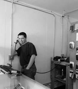 Sheri Samson Bret Towe hard at work in his computer store in Hawthorne.