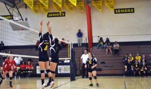 Eric Dahlberg Mineral County's Taylor Isom and Alexceah Emm attempt a block at the net against Whittell Tuesday night. The Lady Serpents won the game 3-2.