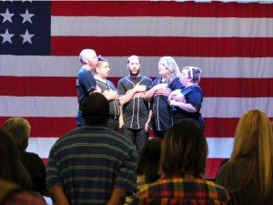Tanya Bunch Reno's improv group, The Utility Players, perform the National Anthem at the Kenny Bostic Memorial Athletic Fund dinner Saturday evening at the Hawthorne Convention Center. The annual event raised money to help local youth with the costs of playing sports throughout the year.