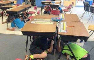Courtesy photo Hawthorne Elementary School students take cover during an earthquake drill last week.