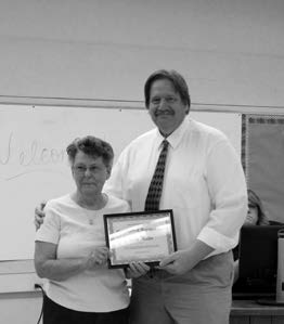 MCIN Mineral County superintendent Walt Hackford presents Lynda Miller with a certificate of recognition for her late husband Virgil.