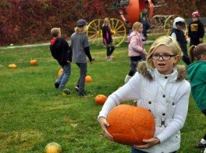 Heidi Bunch Haylee Dalton is shown with her perfect pumpkin at Lion's Park last week.