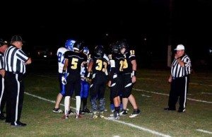 Jason Cardenas The Mineral County and Smith Valley football teams shake hands before their game last Friday in Hawthorne. The Serpents won the contest 88-16.