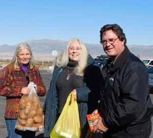 Shari Samson Cherrie George, director of Mineral County Senior Services, is shown with the Niedzwiecki's, who donated the fixings for complete turkey dinners.