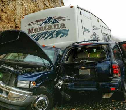 Rock slide causes three-car accident