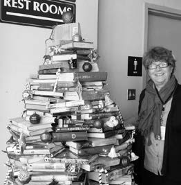 Sheri Samson Library Director Courtney Oberhansli shows off their special tree.