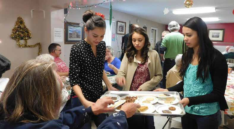 Local churches sponsor Christmas Eve lunch at the Care and Share