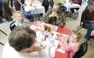 Sheri Samson The Billings share a Valentine's luncheon with kindergarteners Nevada Viani and Dani Llewellyn at the Care and Share.
