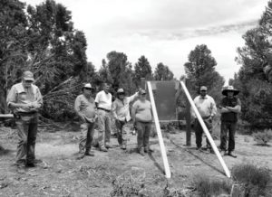 Courtesy photo - U.S. Forest Service workers and volunteers stand near the new interpretative sign installed near the entrance of the Aurora cemetery,