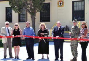 Heidi Bunch photos - Mineral County Economic Development Authority Director Shelley Hartmann (middle) and Lt. Col. Gregory Gibbons (second from right) prepare to cut a ribbon on the Hawthorne Technology and Industrial center at the Army Depot Tuesday.