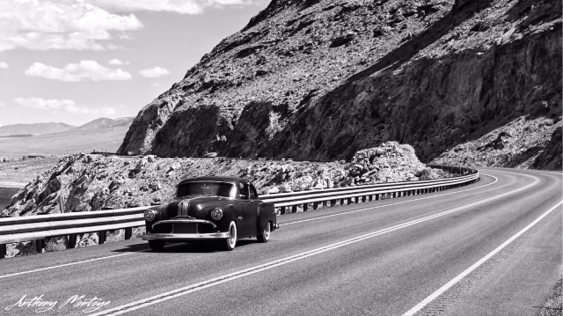 Anthony Montoya A vintage car cruises around 'The Cliffs' of Walker Lake.
