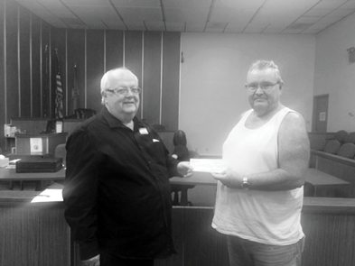Courtesy photo -  Mineral County Search & Rescue was presented a check for over $2,500 at their last scheduled meeting by Glenn Carns, General Manager of the El Capitan Lodge and Casino. Carns and the El Capitan had put together a 75-year anniversary celebration. During the course of the event, donations were collected and a raffle held. Saturday's finale of the event was an off-road poker run in which search and rescue were the beneficiaries. Shown are Carns and Glenn Bunch, President of Mineral County Search and Rescue.