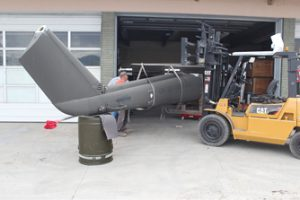 The tail section of a UH-1 Huey Helicopter is stored in the garage at the museum.