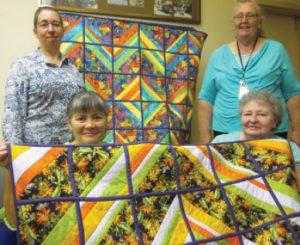 Courtesy photo -  Sew What? Needlecraft Club members Helene Weatherfield, Pearl Fortier, Katharine Pyatt and Christine Clifford display their work.