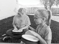 Courtesy photo -  A pair of girls play drums on the lawn of the Boys & Girls Club. The Hawthorne location offers a variety of programs and activities for children.