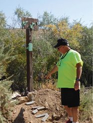 Sheri Samson - Nigel Giddings of Nevada stops to place a penny on a rural memorial