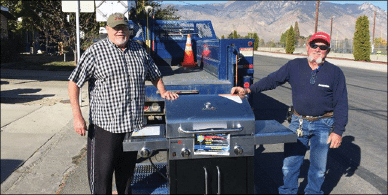 Courtesy photo - Amerigas customer appreciation winner Jim Scott receives his new barbecue from Amerigas employee Keith Heidkamp.