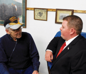Sheri Samson - Incumbent Mineral County Commissioner Paul MacBeth, left, speaks with candidate Garth Price after announcing he was withdrawing from the race at the VFW candidates night.