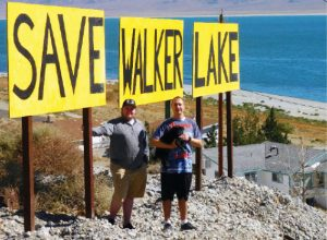 "Sheri Samson - Garth Price stands with cousin, Toby Montoya at the ""Save Walker Lake"" roadside signage."