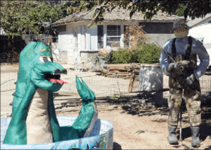 Sheri Samson - Hawthorne resident Pam Jensen has re-created the legendary 'Cecil the Serpent' in the front yard of her home.