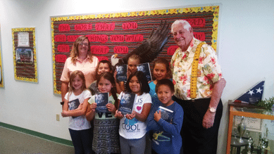 Courtesy photos - Hawthorne Elks Lodge, BPOE 1704 members Bud Lemmond and Cathy Devall are pictured doing their annual tradition of handing out dictionaries to Mineral County third graders at both Hawthorne Elementary and Schurz Elementary.
