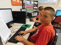 Sheri Samson - Local student Michael Cauley is shown next to Anthony Garcia in Keyboarding 1 class.