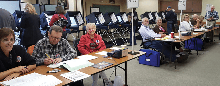 Heidi Bunch  Poll workers kept busy in Hawthorne Tuesday as 2,004 of the 2,945 registered Mineral County voters cast their ballots.