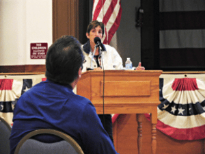 Heidi Bunch - Mineral County Commissioner Jerrie Tipton addressed a small crowd at the school bond town hall meeting last week. Tipton explained how the county tax revenue is set up and answered questions from those in attendance.