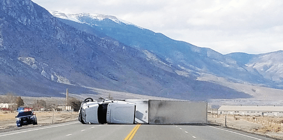 Reported gusts of 75 mph topple trees, trucks; close highway