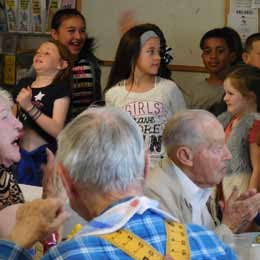 Students sing at Care and Share