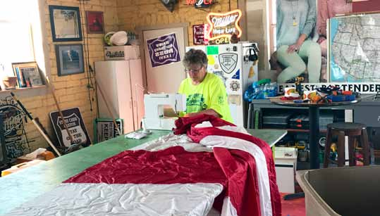 Local Woman Helps Keep Hawthorne's Big Flag Flying