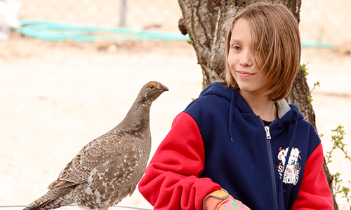 Local Girl Makes Unusual Friend Outside Army Depot Home
