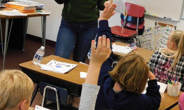 Junior Achievement Volunteers Visit Elementary School Students