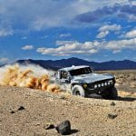 Tanya BunchA trophy truck races past Pit 9 at Redlich Summit on its way to the Mina Pit during Friday's Best in the Desert race.