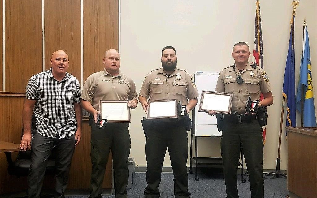 Local Officers Awarded Life Saving Medal