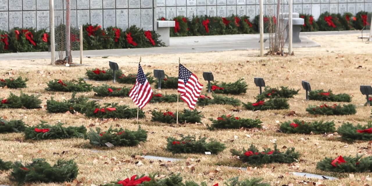Family, Volunteers Honor Veterans by Placing Wreaths on Gravesites