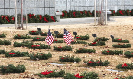 Family, Volunteers Honor Veterans by Placing Wreaths on Gravesites